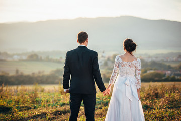 Wedding couple, summer evening light, white edit space