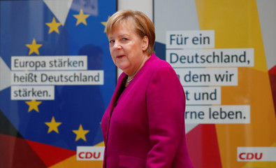 German Chancellor Angela Merkel arrives to give a statement at the CDU headquarters in Berlin