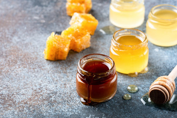 Honey, honey dipper and honeycombs. Healthy lifestyle, healthy eating produts. Craft honey in jars