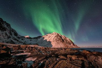 Night winter landscape with Northern lights, Aurora borealis. Scenery view of the Lofoten Islands, Norway