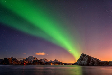 Photo sur Toile Aurore polaire Northern lights, Aurora borealis in Lofoten islands, Norway. Night winter landscape with polar lights and beautiful starry sky