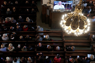 Faithful attend the ecumenical church service with Pope Francis at the Riga Dome Cathedral in Riga