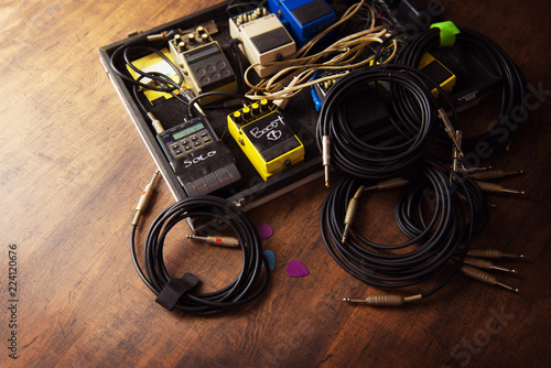 Electric guitar audio processing effects on a studio floor