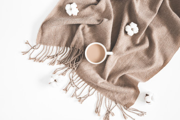 Autumn or winter composition. Cup of coffee, plaid, dried leaves, cotton flowers on white background. Autumn, fall, winter concept. Flat lay, top view