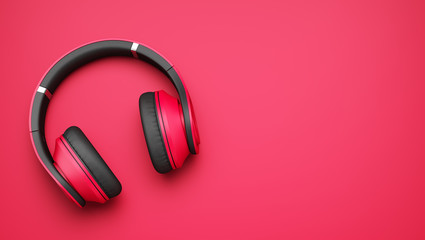 pink and black wireless headphones isolated on pink background