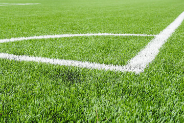 Marking the angle of the football field with artificial surface.