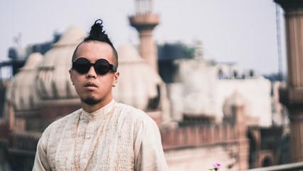 Guy in kurta on a rooftop in Old Dehli