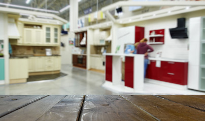 Defocused, blurred image of the department of kitchen furniture sets.