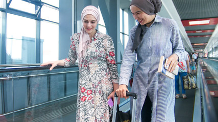 Two muslim girls on the way to the airport close up