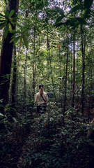 Girl trekking in the jungle, jungle hiking