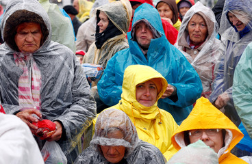 Pilgrims gather outside of the Aglona Basilica ahead of Pope Francis' arrival in Aglona