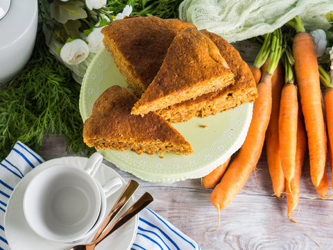 Spiced carrot cake with walnuts and cinnamon with breakfast setting background