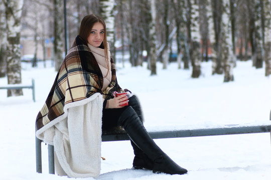 Young beautiful girl in winter snowy day
