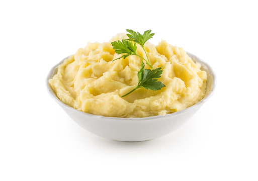 Mashed potatoes in bowl isolated on white.