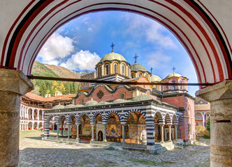 Beautiful view of the Orthodox Rila Monastery, a famous tourist attraction and cultural heritage monument in the Rila Nature Park mountains in Bulgaria Wall mural