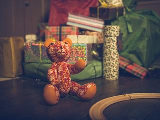 Teddy bear under christmas tree