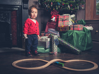 Little boy with wooden train at christmas
