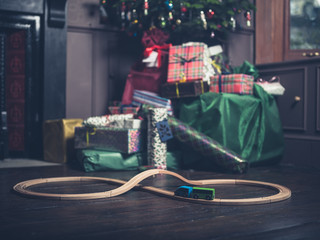 Wooden toy train with christmas tree in background