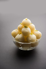 Indian Rasgulla or dry Rosogulla dessert/sweet served in a bowl. selective focus