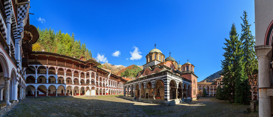 Beautiful panoramic panorama of the Orthodox Rila Monastery, a famous tourist attraction and cultural heritage monument in the Rila Nature Park mountains in Bulgaria Wall mural