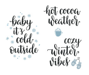 Winter seasonal inspirational lettering set. Baby its cold outside, Hot cocoa weather, Cozy winter vibes hand written calligraphy
