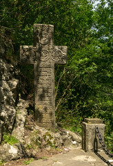 Mysterious ancient stone cross with runic symbols