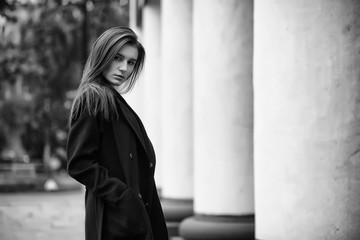 Girl in a coat black and white photo