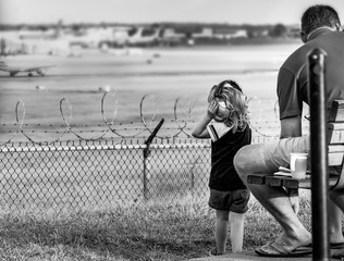 Child Watches Airplanes Black and White