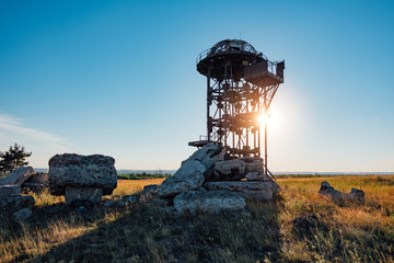 Old rusty iron abandoned watch tower in wastelands