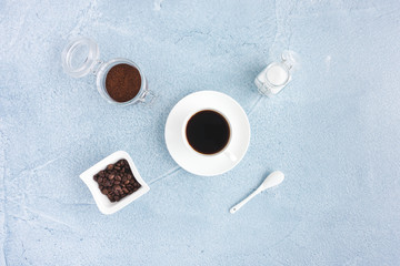 Black Coffee in Cup, Coffee Beans, Ground Coffee and White Sugar