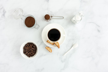 Black Coffee, Cantucci, Cup, Sugar, Ground Coffee and Beans