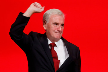 The Labour Party's shadow Chancellor of the Exchequer John McDonnell raises his fist after speaking at the party's conference in Liverpool