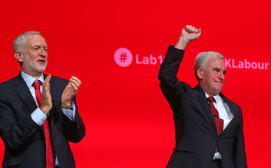 Britain's shadow Chancellor of the Exchequer John McDonnell acknowledges the applause after delivering his keynote speech at the annual Labour Party Conference in Liverpool