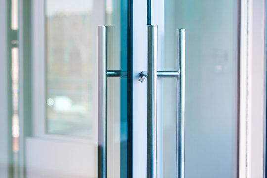 Close-up of Aluminum glass door handle.