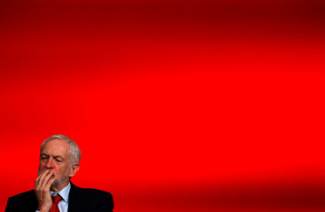 Labour Party leader Jeremy Corbyn listens as the Shadow Chancellor of the Exchequer John McDonnell speaks at the party's conference in Liverpool