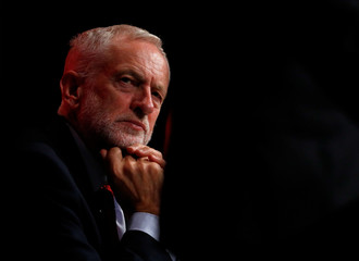 Labour Party leader Jeremy Corbyn looks on as the Shadow Chancellor of the Exchequer John McDonnell speaks at the party's conference in Liverpool