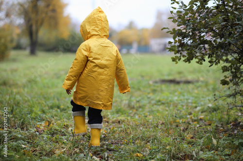1a7bc954b A child in a raincoat for a walk outside