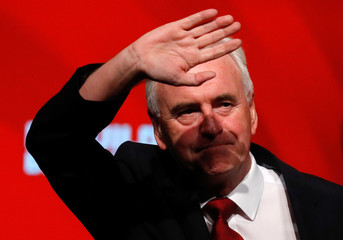 The Labour Party's shadow Chancellor of the Exchequer John McDonnell waves after speaking at the party's conference in Liverpool