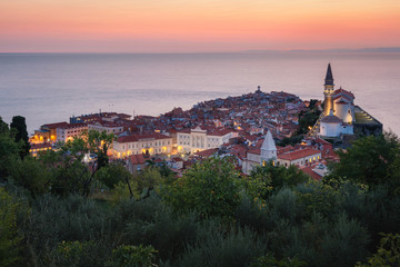 Romantic colorful sunset over picturesque old town Piran, Slovenia. Scenic panoramic view.