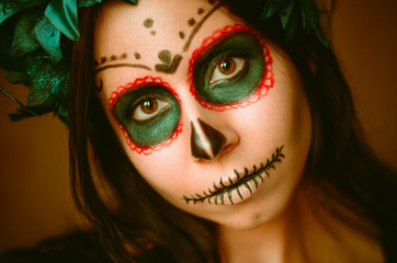 Young caucasian woman in catrina calavera style makeup horizontal portrait close up face