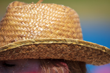 Straw hat on the girl's head