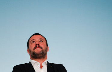 Italy's Interior Minister Matteo Salvini looks up during a news conference with Prime Minister Giuseppe Conte after to approve a new decree of the measures on immigration and security at Chigi Palace in Rome