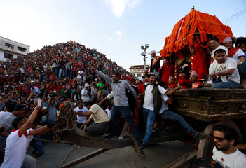 Devotees pull the chariot of Living Goddess Kumari during the Indra Jatra Festival in Kathmandu