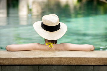 Rear view of asian woman with hat relaxing