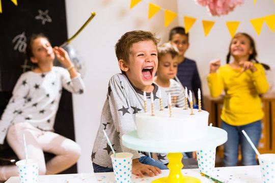 Little boy having fun on his birthday celebration