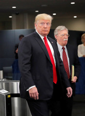 U.S. President Donald Trump arrives at United Nations headquarters with National Security Advisor John Bolton during 73rd United Nations General Assembly in New York