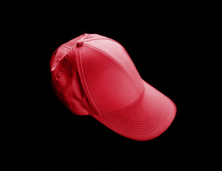 Red baseball cap on black background. Template for placing your design.