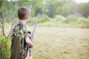 Boy With Shotgun While Dove Hunting