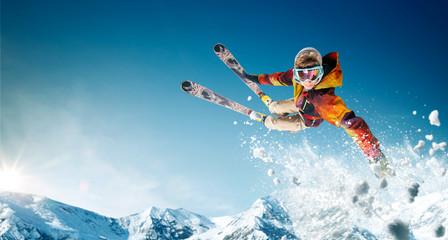 Photo sur cadre textile Glisse hiver Skiing. Jumping skier. Extreme winter sports.