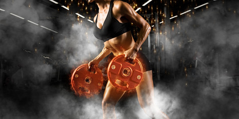 Women workout with disc barbell